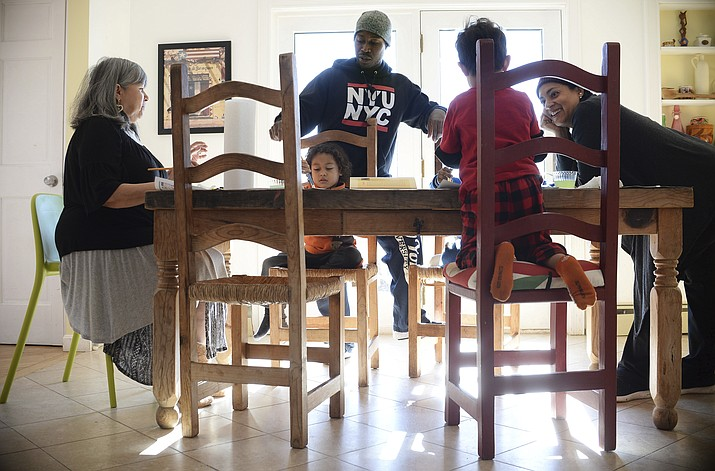 Artist and author Maybeth Morales, left, leads a home school art class for her grandchildren as her daughter Chemay Morales-James, right, and son-in-law Shane, center, watch in Watertown, Conn. Reports that 13 malnourished siblings allegedly held captive by their parents were home-schooled has others who educate their children at home bracing for calls for more oversight of the practice, a reaction they say would unfairly punish families. (AP Photo/Jessica Hill)