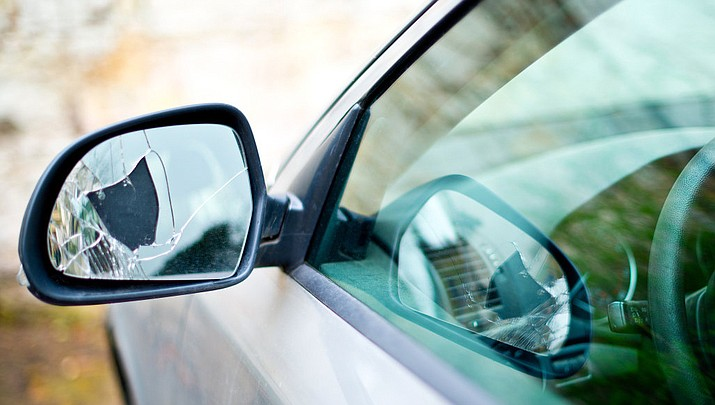 Minor infractions, like a broken side-view mirror, can attract the attention of law enforcement. Most of the time police will issue a repair order rather than a ticket, officers say. (Stock image)