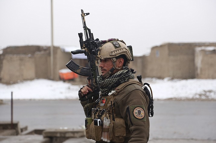 A member of Afghan security personnel arrives at the site of an attack at a military academy in Kabul, Afghanistan Monday, Jan. 29, 2018. Insurgents attacked an Afghan army unit guarding the military academy in the capital Kabul on Monday, officials said. (AP Photo/ Rahmat Gul)