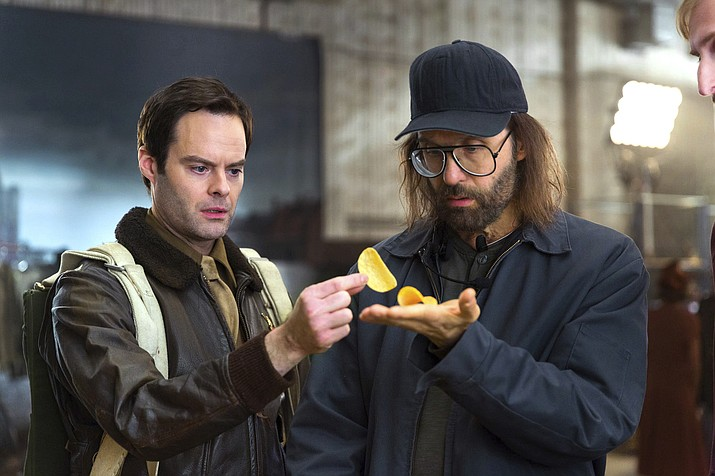 This photo provided by Pringles shows a scene from a Pringles Super Bowl spot, featuring actors Bill Hader, left, and Sky Elobar. For the 2018 Super Bowl, marketers are paying more than $5 million per 30-second spot to capture the attention of more than 110 million viewers. (Rob Kalmbach/Pringles)