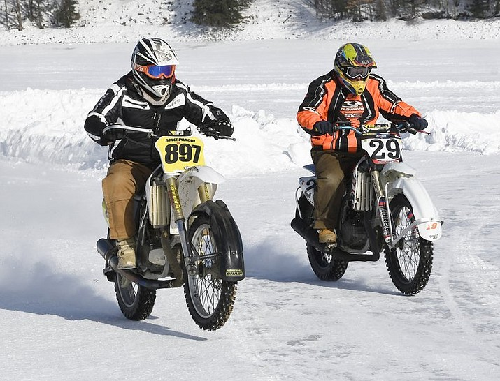 "In this Jan. 7, 2018 photo Mike Parodi, left, and Floyd Billington, both of South Glens Falls, practice ice racing on Great Sacandaga Lake in Northville, N.Y. ""Believe it or not, at 18 below, it actually doesn't feel that bad,"" said Parodi. ""The adrenaline of going 70 mph and dragging across the ice is something you can't find anywhere else."" (AP Photo/Hans Pennink)"