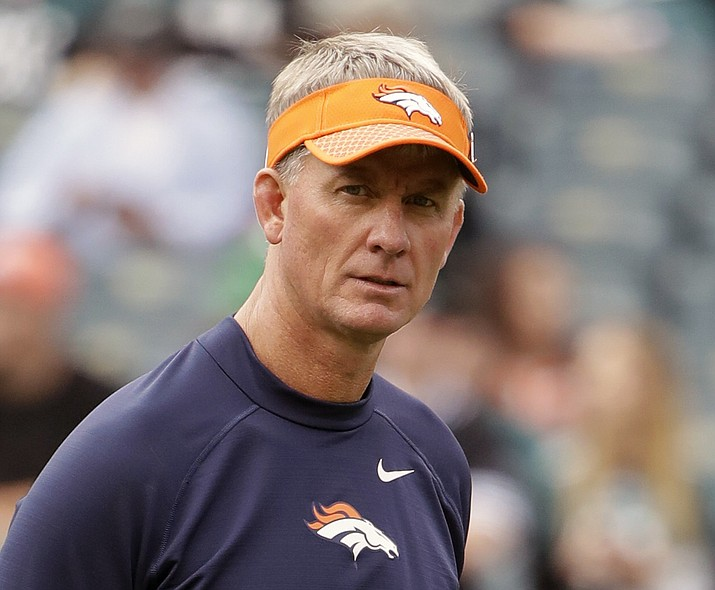 In this Nov. 5, 2017, file photo, former Denver Broncos' coach Mike McCoy walks the field before a game against the Philadelphia Eagles in Philadelphia. McCoy is now the offensive coordinator for the Arizona Cardinals. (Matt Rourke/AP, File)
