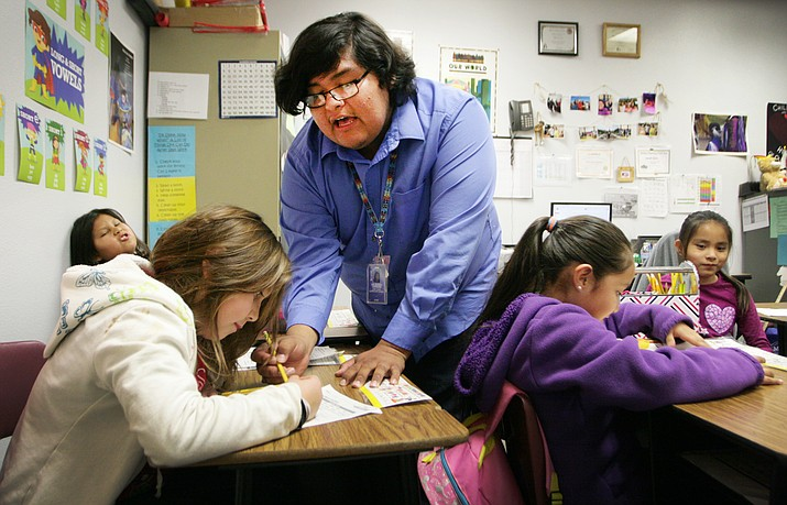 """I believe each one of my students who come through my door can and will succeed,"" Says Delmundo Cepress, Johnson O'Malley Tutor at Camp Verde Elementary School. ""I understand that each student is very unique in their own way, but that is what makes them special to me."" (Photo by Bill Helm)"
