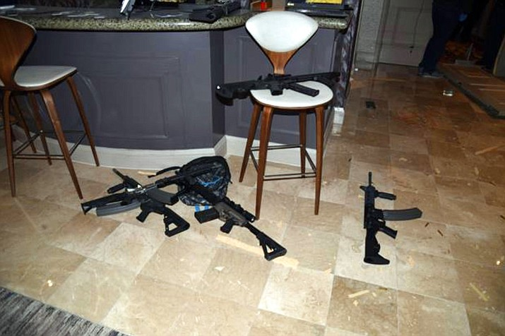 This October, 2017 photo shows the kitchenette in the hotel room of Las Vegas gunman Stephen Paddock's 32nd floor room of the Mandalay Bay hotel in Las Vegas. The name of a man identified in court documents as a person of interest in the deadliest mass shooting in modern U.S. history was publicly revealed because of a court error. Clark County District Court Judge Elissa Cadish said Tuesday, Jan. 30, 2018, that her staff failed to black out the name in nearly 300 pages of documents released to news organizations including The Associated Press and Las Vegas Review-Journal. (Las Vegas Metropolitan Police Department)