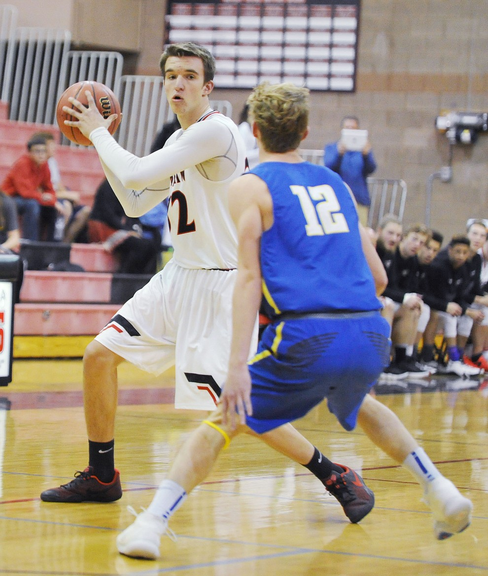 Bradshaw Mountain's Ben Petro looks to pass as the Bears hosted crosstown rival Prescott Tuesday night in Prescott Valley. (Les Stukenberg/Courier)