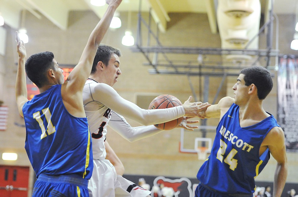 Bradshaw Mountain's Ben Petro gets stipped by Prescott's Charles Hicks as the Bears hosted crosstown rival Prescott Tuesday night in Prescott Valley. (Les Stukenberg/Courier)