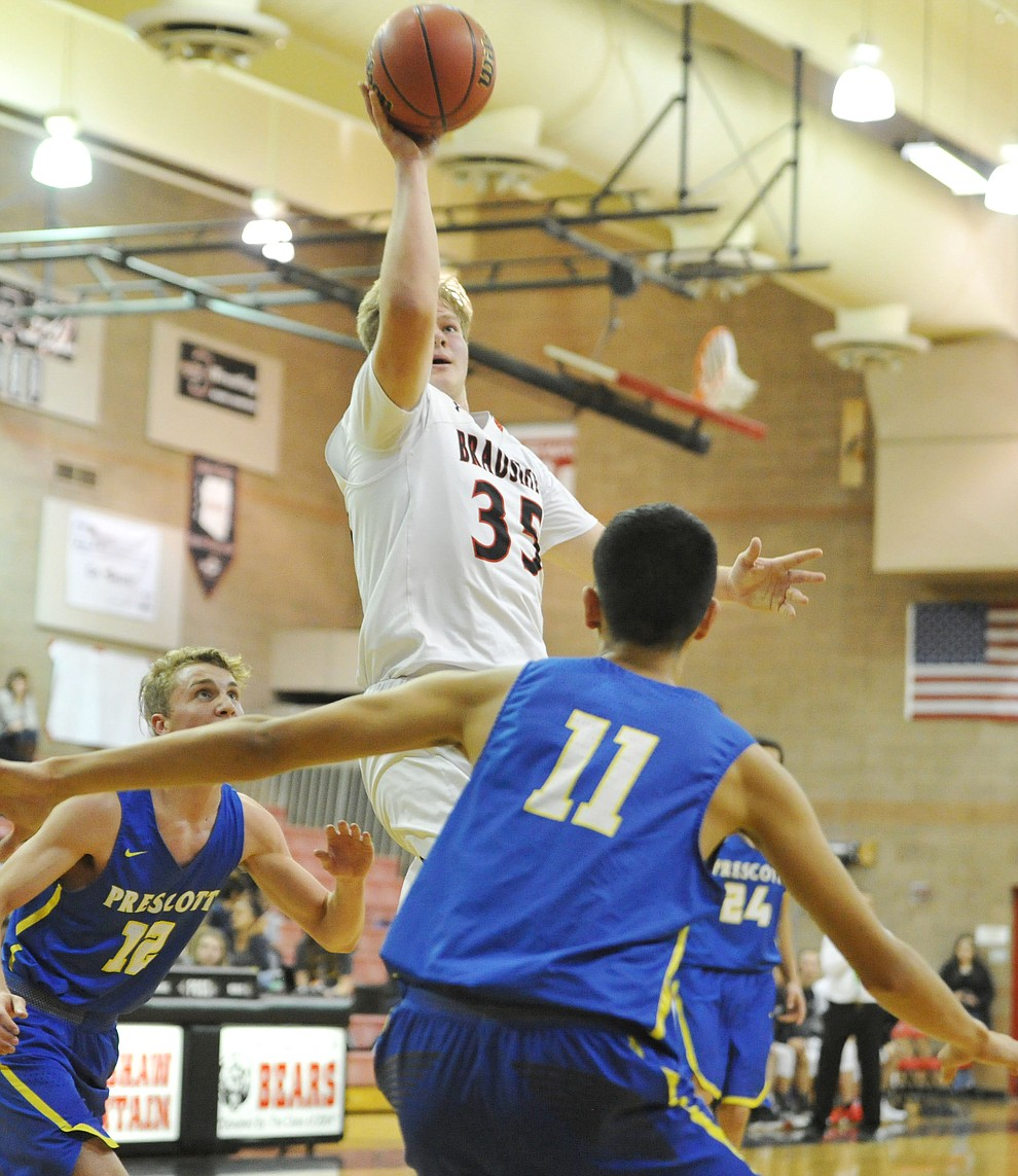 Bradshaw Mountain's Travis Lamb goes up for two points as the Bears hosted crosstown rival Prescott Tuesday night in Prescott Valley. (Les Stukenberg/Courier)