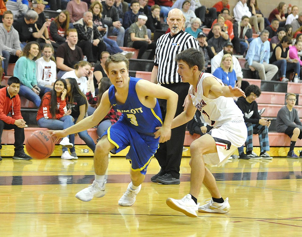 Prescott's Justin Kimball drives as the Badgers traveled to crosstown rival Bradshaw Mountain Tuesday night in Prescott Valley. (Les Stukenberg/Courier)