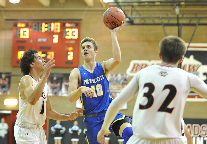 Prescott's Kody Jones (10) takes a shot as the Badgers traveled to cross-town rival Bradshaw Mountain on Tuesday, Jan. 30, 2018, in Prescott Valley. Jones had seven points, 12 rebounds and six assists in a 57-46 win over the Bears. (Les Stukenberg/Courier)