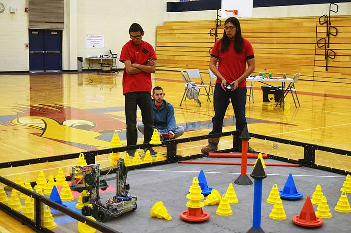 Holbrook High School robotics students Devin Etsitty, Joshua Kishbaugh and Ambros Jackson practice for the Painted Desert In the Zone — VEX skills Robotics Competion.