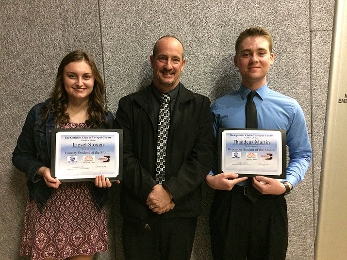 Liesel Stoxen (January), Bradshaw Mountain High School Principal Kort Miner and Thaddeus Martin (December) are recognized as the students of the month. (Courtesy)
