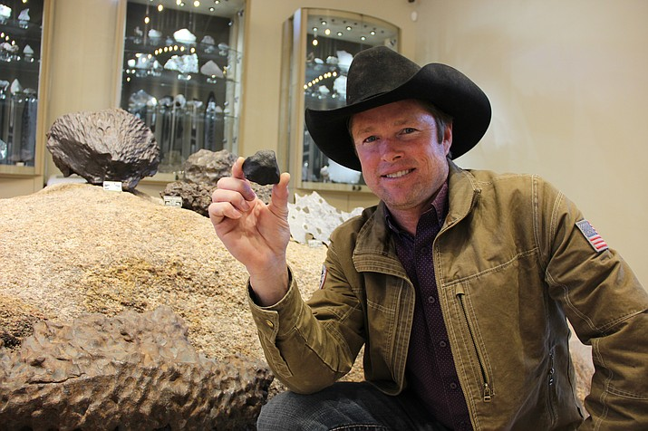 Local meteorite hunter Robert Ward shows off the most recent addition to his collection, a meteorite he found atop the frozen lake near Hamburg, Michigan. (Max Efrein/Courier)