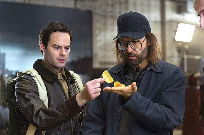 This photo provided by Pringles shows a scene from a Pringles Super Bowl spot, featuring actors Bill Hader, left, and Sky Elobar. For the 2018 Super Bowl, marketers are paying more than $5 million per 30-second spot to capture the attention of more than 110 million viewers.