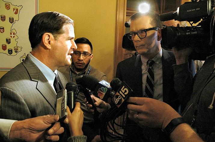 Gov. Doug Ducey takes questions from reporters Friday after signing into law major changes in Arizona laws that address opioids. (Photo by Howard Fischer/Capitol Media Services)