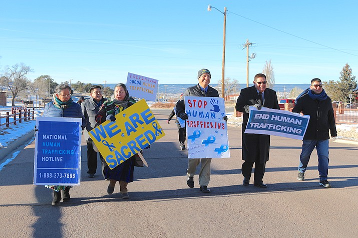 "Participants in the Human Trafficking ""Blue Campaign"" Awareness Walk march through Window Rock Jan. 22."