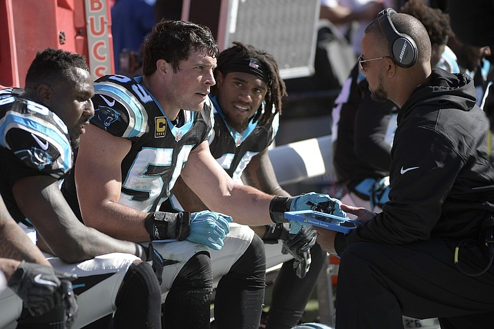 Carolina Panthers linebackers coach Al Holcomb, right, talks with middle linebacker Luke Kuechly (59) on the bench during the second half game against the Tampa Bay Buccaneers Sunday, Oct. 29, 2017, in Tampa, Fla. (Phelan M. Ebenhack/AP, File)
