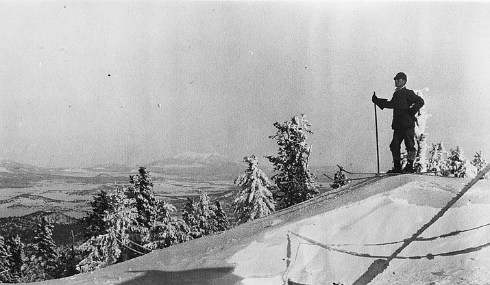 Harold Greene waits to descend a slope on Bill Williams Mountain in 1909.