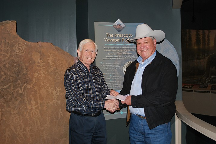 Jim Webb (right) presents a check from the Kemper and Ethel Marley Foundation to Fred Veil (left), executive director of the Sharlot Hall Museum, to bring the Museum's fundraising effort near its goal of $2.25 million. (Courtesy)