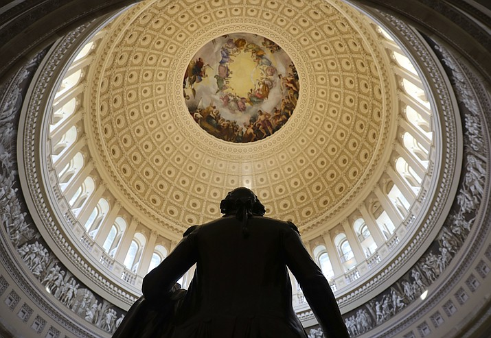 The Capitol Rotunda is seen with the statue of George Washington on Capitol Hill in Washington, Tuesday, Jan. 30, 2018, ahead of the State of the Union address by President Donald Trump. (AP Photo/Pablo Martinez Monsivais)