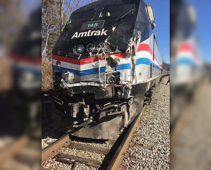 The damaged front of an Amtrak train carrying Republican members of Congress to a retreat Wednesday. The train hit a garbage truck near Charlottesville, Va. The driver of the truck died. (Rep. Jeff Denham/Twitter)