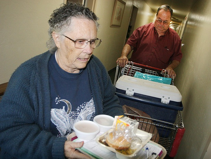 "Marie DeClue and Ron Posten deliver meals to Camp Verde senior citizens twice each week. According to DeClue, the meal she and Posten deliver is for some people ""the only food they get each day."""