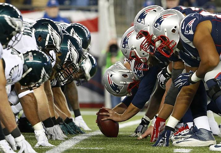In this Dec. 6, 2015, file photo, the New England Patriots, right, and the Philadelphia Eagle get set for the snap at the line of scrimmage during an NFL football game at Gillette Stadium in Foxborough, Mass. The two teams are set to meet in Super Bowl 52 on Sunday, Feb. 4, 2018, in Minneapolis. (Winslow Townson/Panini via AP, File)