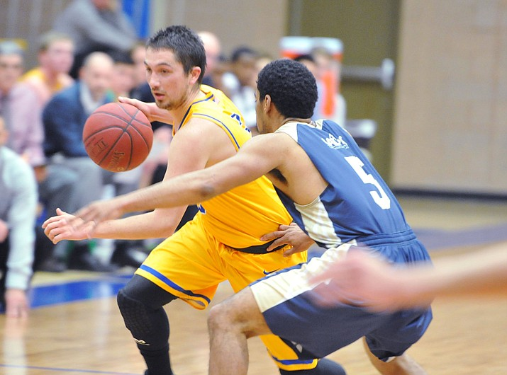 Embry Riddle's Ryan Skurdal drives hard to the basket as the Eagles hosted UC-Maritime on Thursday, Feb. 1, 2018, in Prescott. Skrudal scored five points and had four assists in a 83-68 loss to the Keelhaulers. (Les Stukenberg/Courier)
