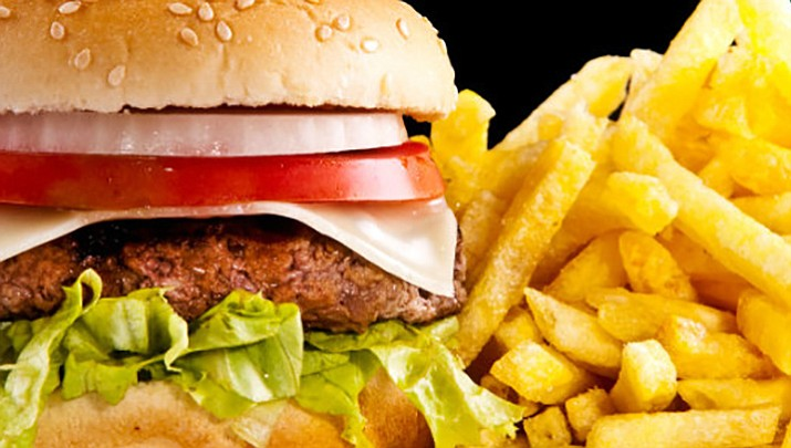 A burger and fries from a fast-food restaurant ... or is this a photo from an advertisement? Do the meals you buy look like the picture in the ad?