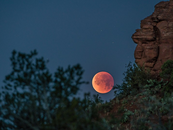Sedona photographer John Hill took this photo of the 'Super Blue Blood Moon' at 6:45 a.m. on Wednesday from Red Rock Loop. The west side of the United States got the best view of the lunar event.