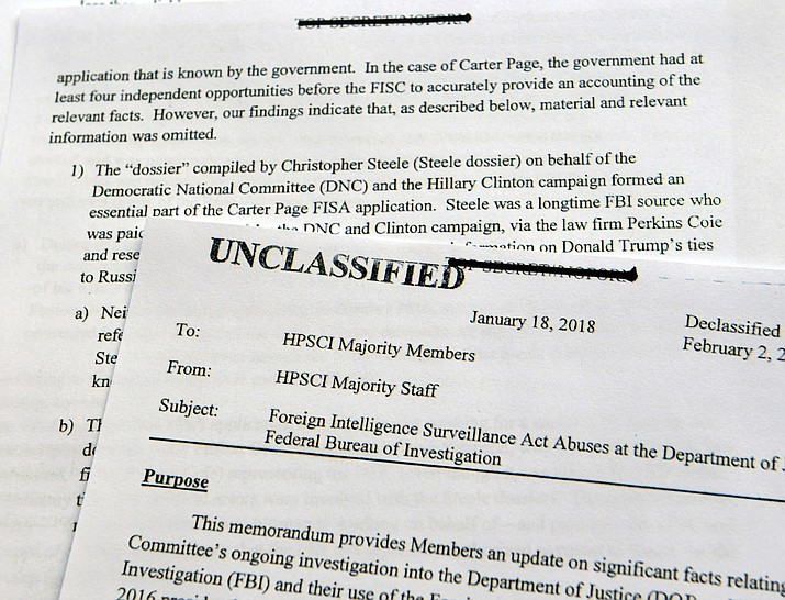 A intelligence memo is photographed in Washington, Friday, Feb. 2, 2018. After President Donald Trump declassified the memo, the Republican-led House Intelligence Committee released the memo based on classified information that alleges the FBI abused U.S. government surveillance powers in its investigation into Russian election interference. (AP Photo/Susan Walsh)