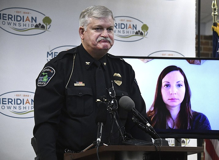 Brianne Randall-Gay listens-in from Seattle via Skype, as Meridian Twp Chief of Police Dan Hall makes a public apology Thursday, Feb. 1, 2018, and then fields questions for the department's failure to investigate Larry Nassar in 2004 when she was molested. (Dale G Young /Detroit News via AP)