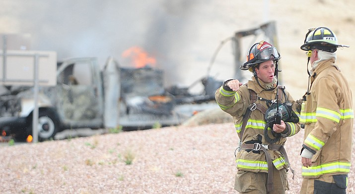 Fire department crews extinguish a fire in a box van in the roundabout from westbound Highway 89A and Granite Dells Parkway in this 2014 file photo. The Prescott Fire Department's insurance rating has improved from a four to two; best is one, worst is 10. (Les Stukenberg/Courier, file)