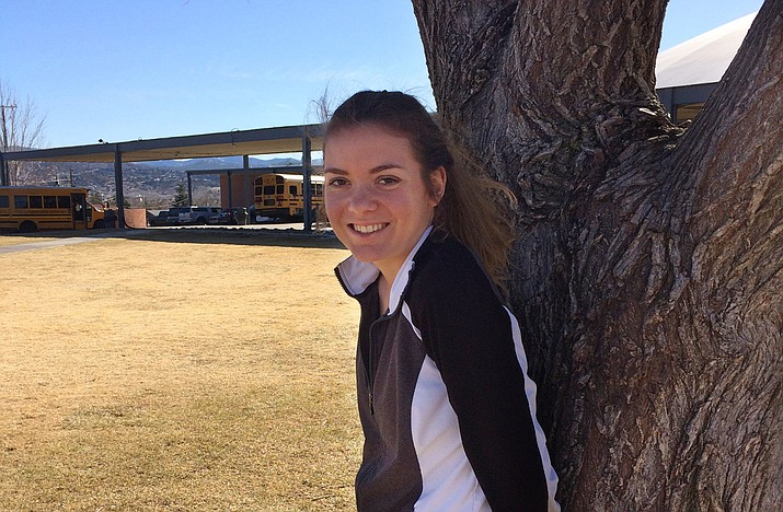 Kirsten Hillig stands next to the Prescott High School elm tree (Nanci Hutson/Courier)