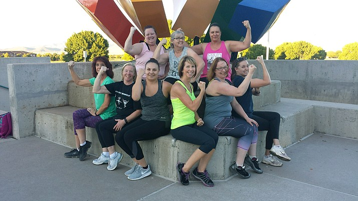 """Katie Folsom-Nelson, center, is surrounded by """"campers' who participated in one of her sessions of Kickstart Bootcamp for Women in Prescott Valley. She said she enjoys the fitness business more than running her own maintenance company, despite the fluctuations that come with running the bootcamp. (Courtesy)"""
