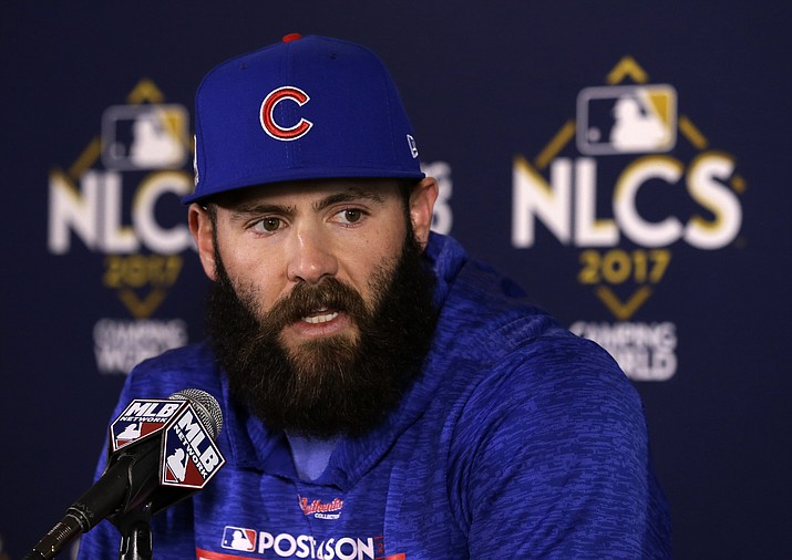 In this Oct. 17, 2017, file photo, Chicago Cubs pitcher Jake Arrieta talks during a news conference before Game 3 of the NLCS against the Los Angeles Dodgers in Chicago. Agent Brodie Van Wagenen, co-head of CAA Baseball, said Friday, Feb. 2, 2018, that baseball players should consider boycotting spring training because of the slow free-agent market. (Charles Rex Arbogast/AP, File)