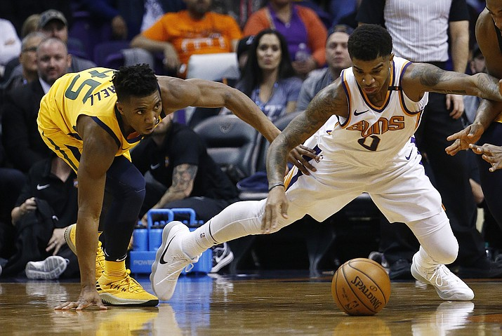 Phoenix Suns forward Marquese Chriss (0) and Utah Jazz guard Donovan Mitchell (45) dive after a loose ball during the first half Friday, Feb. 2, 2018, in Phoenix. (Ross D. Franklin/AP)
