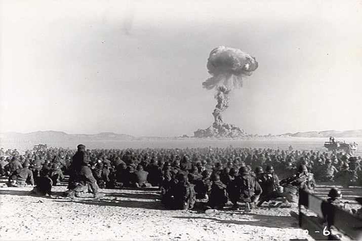 Military personnel watch a 1951 detonation at the Nevada Test Site. (Public domain)