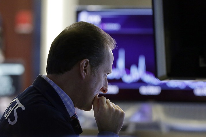 Specialist Glenn Carell works on the floor of the New York Stock Exchange, Friday, Feb. 2, 2018. The stock market closed sharply lower, extending a weeklong slide, as the Dow Jones industrial average plunged more than 600 points. (AP Photo/Richard Drew)