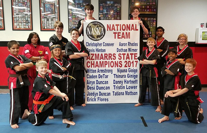 Team KC's poses with their 2017 Championship Banner that will hang in the dojo. (Photo courtesy KC's Family Tae Kwon Do in Cottonwood)