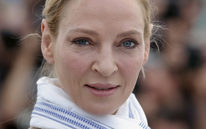 FILE - In this May 18, 2017 file photo, actress Uma Thurman poses for photographers during the photo call for the Un Certain Regard jury at the 70th international film festival, Cannes, southern France. Thurman has accused embattled Hollywood producer Harvey Weinstein of forcing himself upon her sexually and director Quentin Tarantino of making her perform a dangerous car stunt that injured her. Thurman is quoted in The New York Times on Saturday, Feb. 3, 2018, as saying Weinstein attacked her in London. She says he pushed her down and tried to shove himself on her and expose himself. (AP Photo/Alastair Grant)