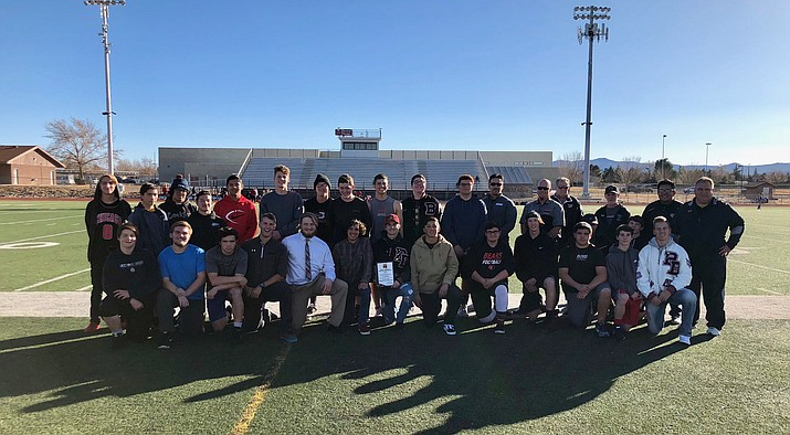 "The Bradshaw Mountain football team poses for a photo after receiving the Matt O. Hanhila Sportsmanship Award on Jan. 23, presented to the ""outstanding team who displayed the best sportsmanship"" in the 4A conference during the 2017 football season. The award is voted on by the members of the Arizona Football Officials Association and presented every year to the selected school. (BMHS/Courtesy)"
