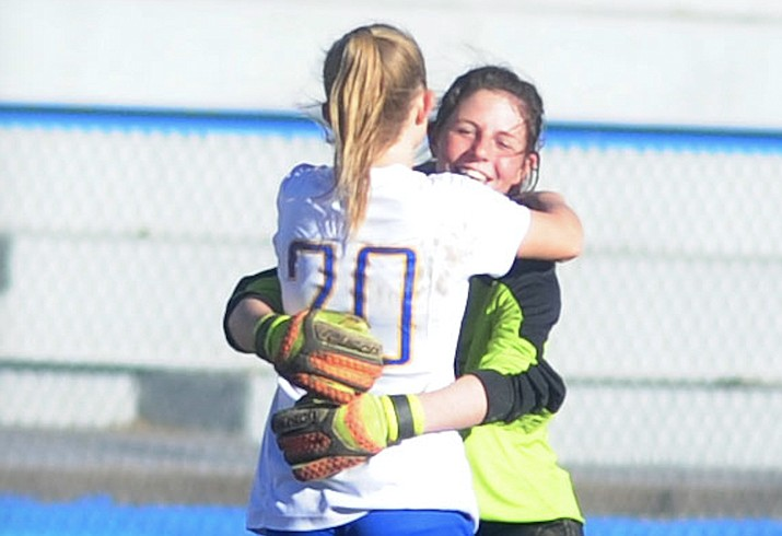 Prescott's Mikayla Sell (20) and goalkeeper Olivia Fletcher embrace after a match Feb. 4, 2017. Sell scored a goal and Fletcher had 11 saves in a 1-0 win over No. 3-ranked Estrella Foothills in the quarterfinals of the 4A state playoffs Saturday, Feb. 3, 2018, in Goodyear. (Les Stukenberg/Courier, File)