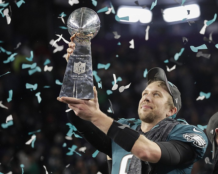 Philadelphia Eagles' Nick Foles holds up the Vince Lombardi Trophy after the NFL Super Bowl 52 football game against the New England Patriots Sunday, Feb. 4, 2018, in Minneapolis. The Eagles won 41-33. (Matt Slocum/AP)