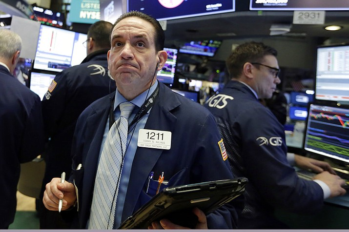 Trader Tommy Kalikas works on the floor of the New York Stock Exchange, Monday, Feb. 5, 2018. Stock markets around the world took another pummeling Monday as investors continued to fret over rising U.S. bond yields. (AP Photo/Richard Drew)
