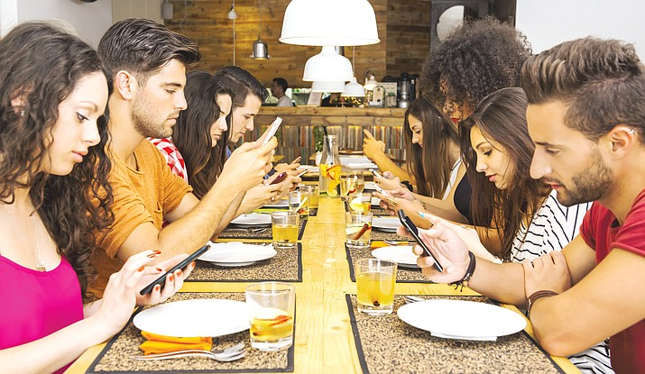 If your social gatherings look like this, then you and your friends might be addicted to smartphones. (Stock)
