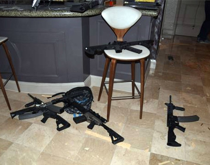 Bump stocks, the device that allow's semi-automatic rifles to mimic the rapid fire of machine guns, were attached to a half-dozen of the long guns found in the hotel room of the Las Vegas shooter who in October 2017 killed 58 people and injured hundreds more attending a nearby outdoor concert. (Las Vegas Metropolitan Police Department)