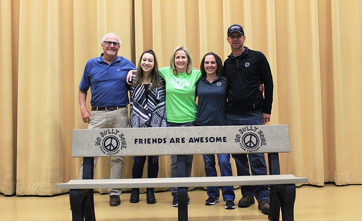 Bob Riva, Maya Caldwell, Pizza Factory CEO Mary Jane Riva and Williams Pizza Factory owners Kendra and Derrick Wornter partner to provide a Buddy Bench at Williams Elementary-Middle School.