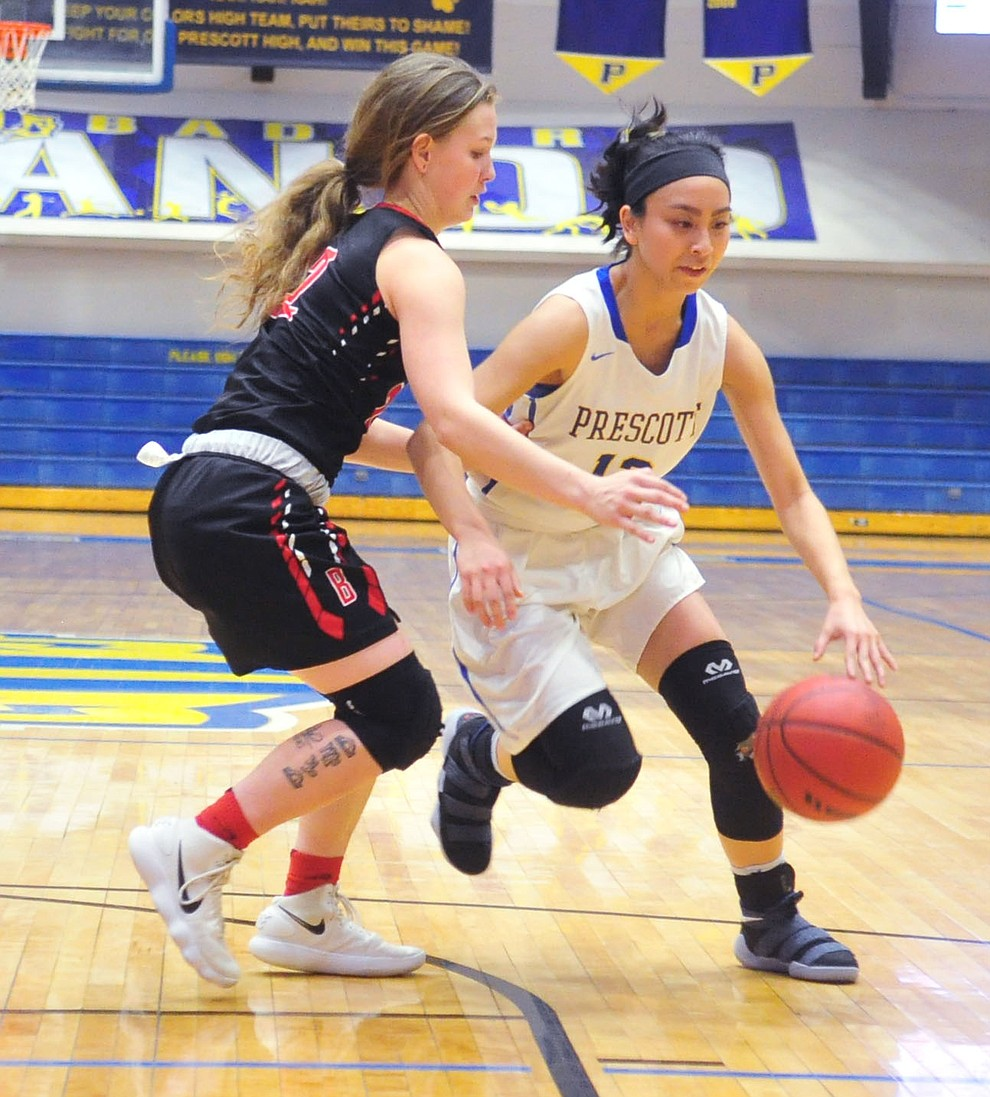 Prescott's Theresa Gutierrez tries to drive around Bradshaw Mountain's Mica Nellis as the Badgers hosted crosstown rival Bradshaw Mountain for the season finale Tuesday night.  (Les Stukenberg/Courier)