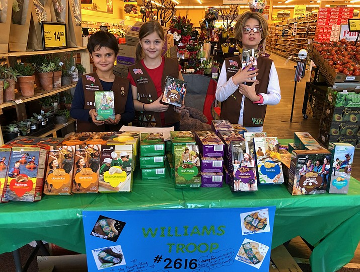 Brownie Troop 2616 members Jenna Wouters, Samara Bowden and Bella Bruno sell Girl Scout Cookies at Safeway.