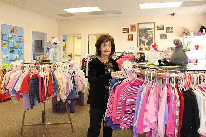 Charlene Duffy, assistant director of Advice and Aid Pregnancy Center, stands by a rack of children's clothes at the center. She doubts a report about declining teen pregnancy.